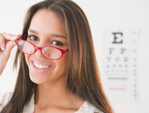 Girl with glasses and eye chart